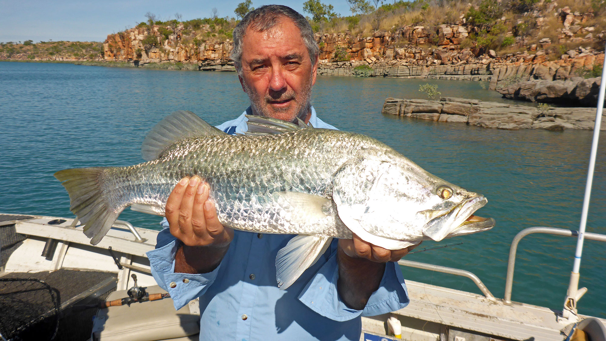 Happy Angler with Barramundi caught on Peter Tuckers Sportfishing Tour